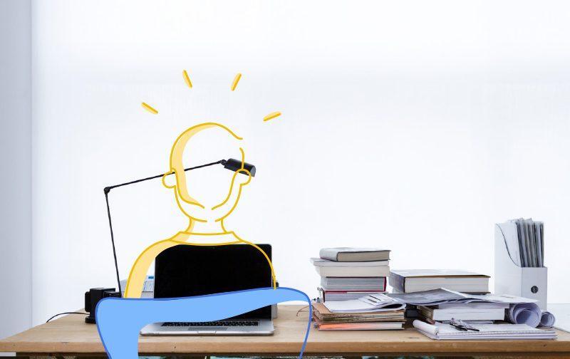 espaces de travail, silhouette dessiné en jaune, sur un bureau avec une lampe et des livres