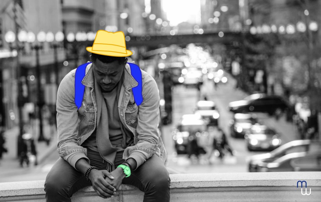 risques psychosociaux un homme avec un chapeau assis tête baissé